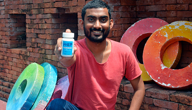 Niluka Perera from Youth Voices Count holds a promotional PrEP bottle. PrEP is an HIV prevention tool made from a combination of two existing drugs that treat HIV