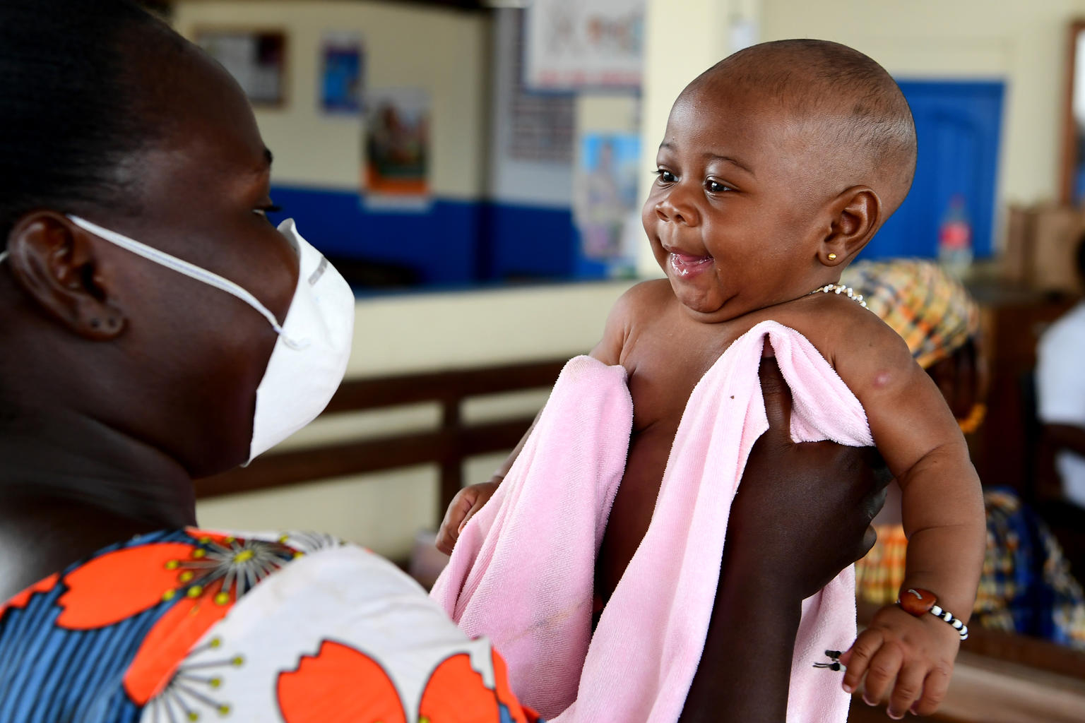3 months old baby waiting to be weighted and vaccinated in a health center in Cote D'Ivoire