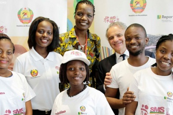 Five adolescent and young girls receive a special award on World AIDS Day for winning the SMS BIZ/U-Report girl-to-girl competition